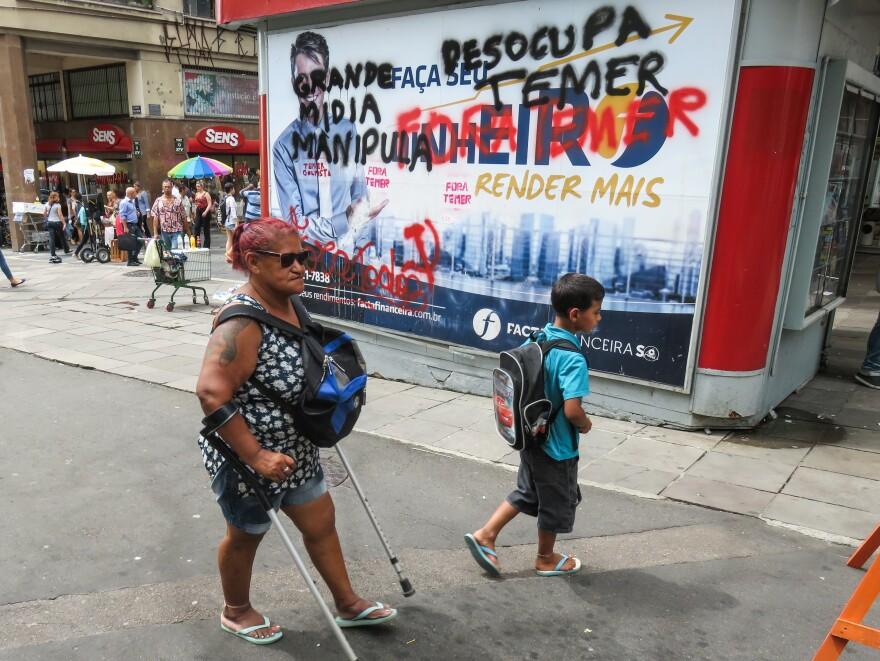 In downtown Porto Alegre, graffiti calls for the ouster of President Michel Temer.