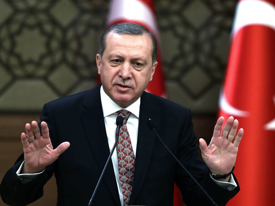 Turkish President Recep Tayyip Erdogan, shown here on Feb. 10 at his Ankara palace, remains popular with conservative and religious Turks, while his critics face a growing crackdown.