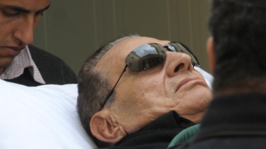 Former Egyptian president Hosni Mubarak arrives by gurney to a court in Cairo, Egypt on Thursday.