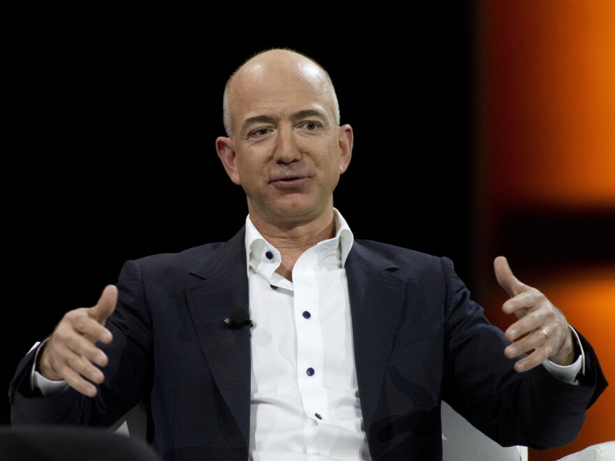Jeff Bezos, a tech titan and Amazon founder, purchased a venerable newspaper, <em>The Washington Post</em>.