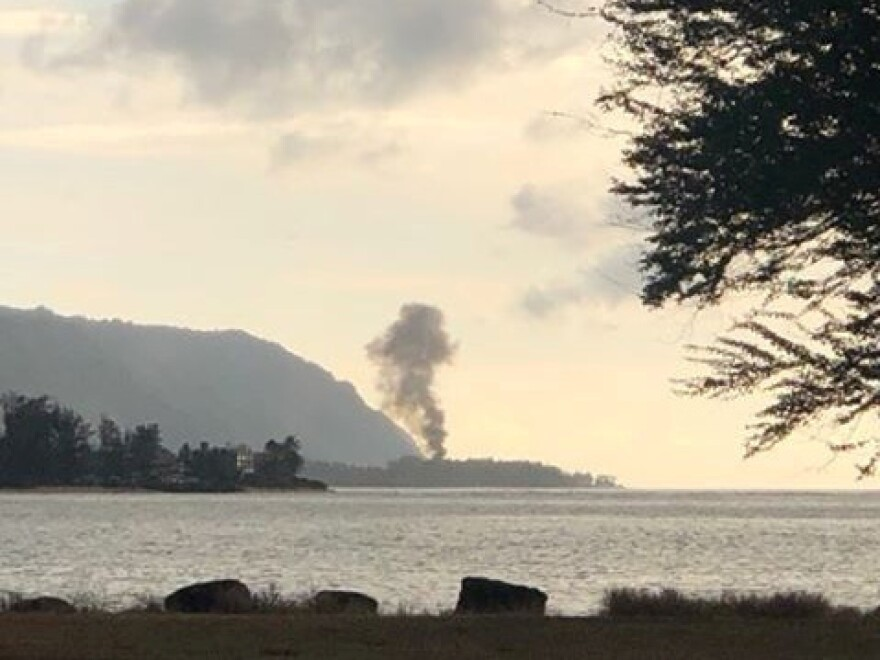 A plume of smoke rises after an airplane crash Friday, seen from Kaiaka Bay Beach Park, in Haleiwa, Hawaii.