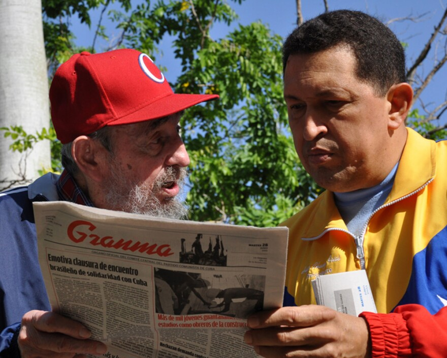 This handout photo released by the Cuban website www.cubadebate.cu shows former Cuban President Fidel Castro and Venezuelan President Hugo Chavez reading Tuesday's edition of the state newspaper <em>Granma</em> in Havana on Tuesday.