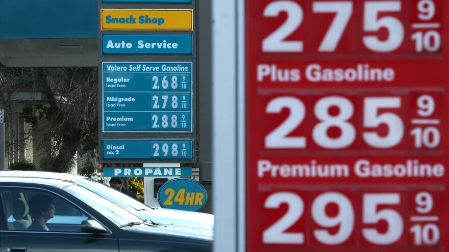 Drivers pass by gas prices that are displayed at Valero and 76 gas stations on Feb. 9, 2015, in San Rafael, Calif.