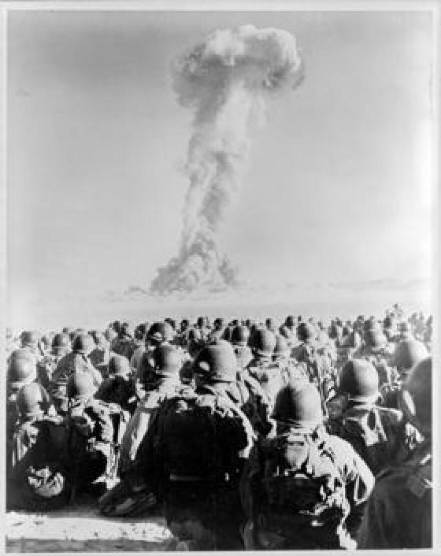 Soldiers watch the detonation of an atomic bomb in Nevada in 1951.