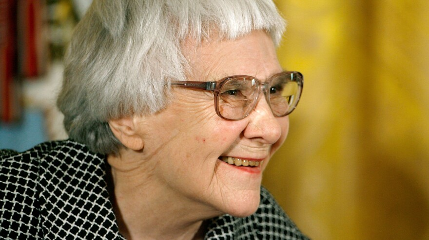 <em>To Kill a Mockingbird</em> author Harper Lee smiles before receiving the Presidential Medal of Freedom in November 2007.