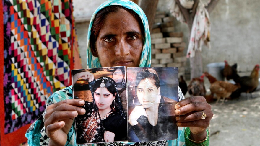 A family member shows pictures of Qandeel Baloch in 2016.