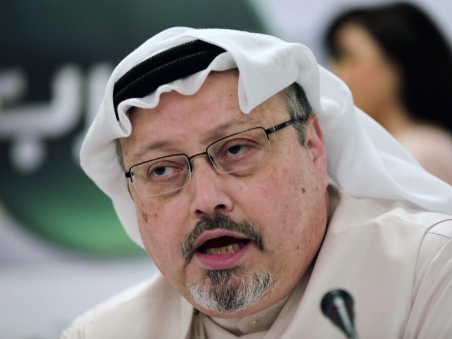 Saudi journalist Jamal Khashoggi speaks during a news conference in Manama, Bahrain, in 2014.