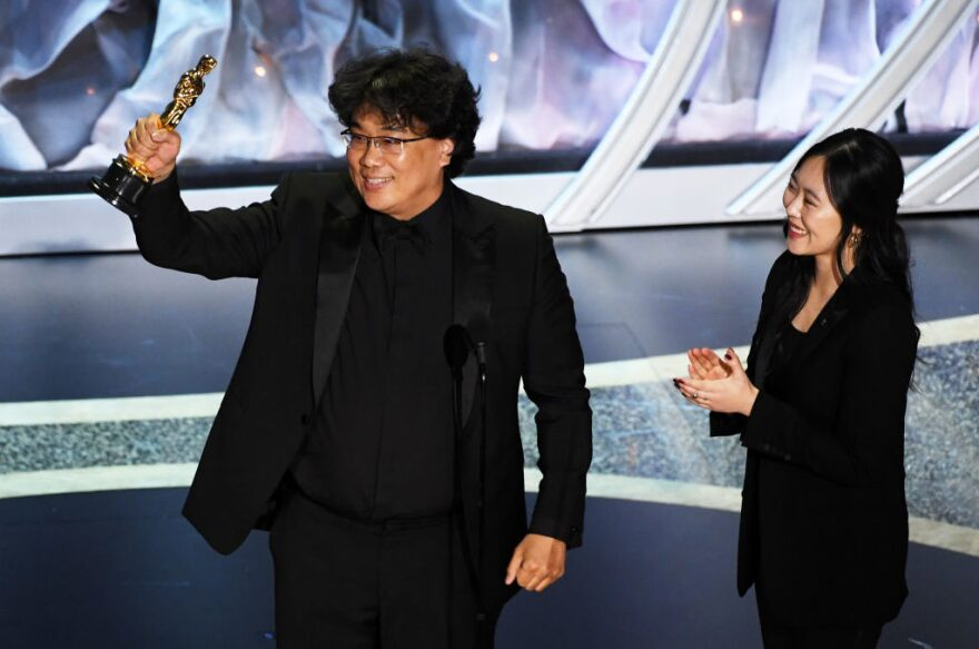 "Bong Joon-ho accepts the International Feature Film award for ""Parasite"" with interpreter Sharon Choi onstage during the 92nd Annual Academy Awards. (Kevin Winter/Getty Images)"