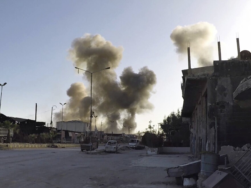 Smoke rises after Syrian government airstrikes hit the town of Douma.