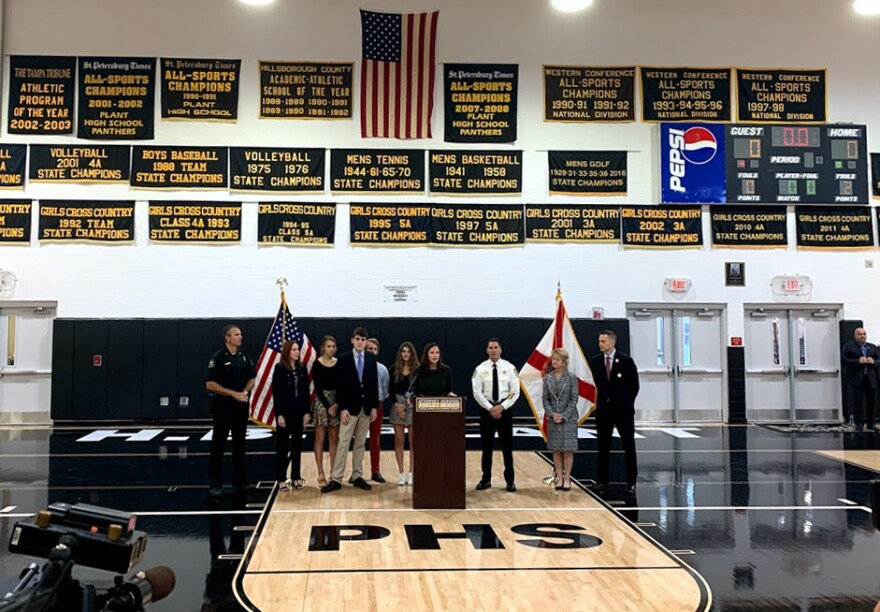 Attorney General Ashley Moody was flanked by high school students, two sheriffs and the Hillsborough County superintendent of schools during her news conference Wednesday.