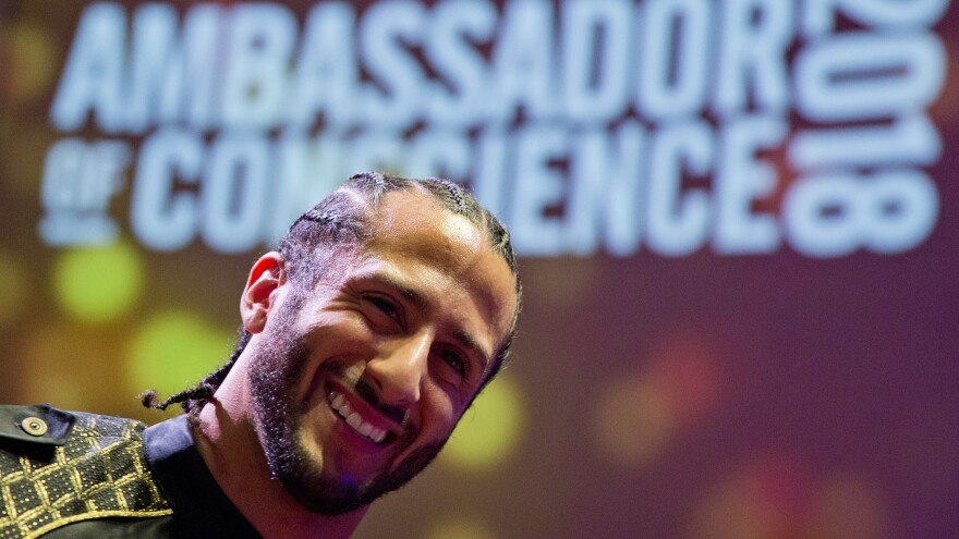 Former NFL quarterback Colin Kaepernick receives the Amnesty International Ambassador of Conscience Award for 2018 in Amsterdam Saturday. Kaepernick became a controversial figure when he refused to stand for the national anthem, and instead knelt to protest racial inequality and police brutality.