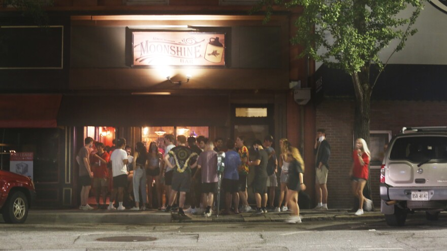 On Monday night at around 11 p.m., the bar strip in downtown Athens was overflowing with students, most not wearing masks