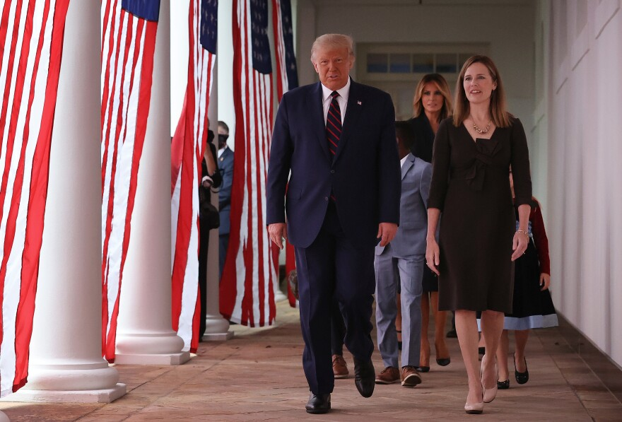 President Trump and Supreme Court nominee Amy Coney Barrett walk along the Rose Garden Colonnade on Saturday. The focus on the court just weeks before the election could help energize conservatives in key states.