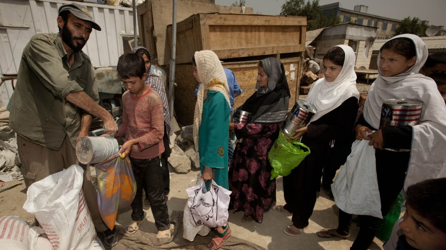 International aid has poured into Afghanistan in recent years, but it is expected to fall sharply as NATO forces pull out. That will place great strains on the economy, and may lead skilled Afghans to leave if they can't find work. Here, street children in Kabul collect food from an aid group.
