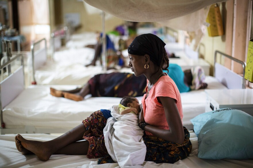 Maternal mortality rates are going down because of better health services. Above: A mother nurses her newborn at a maternity ward in Sierra Leone.