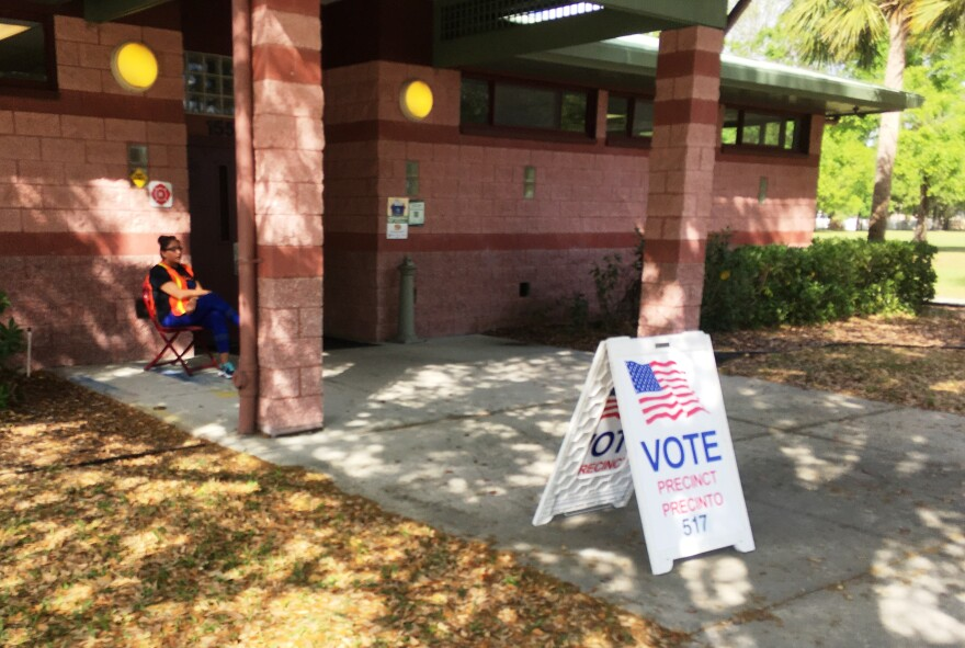 Poll worker sits alone