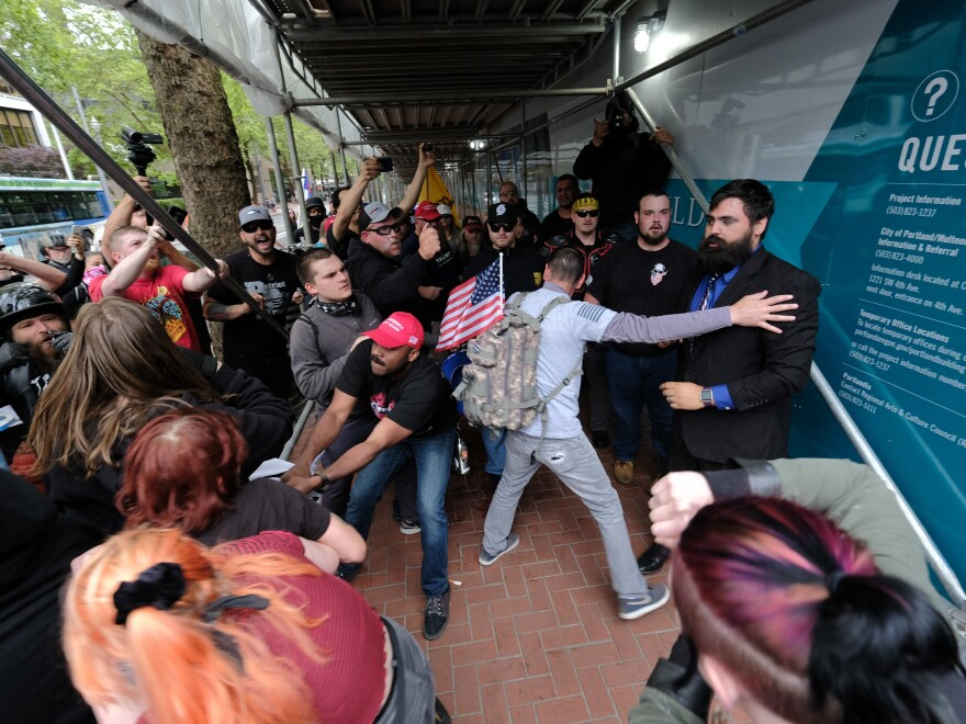 Saturday's clashes were not the first of their kind. (Above) Antifa counterprotesters fought with far-right Patriot Prayer supporters during a march in Portland, Ore., on June 3.