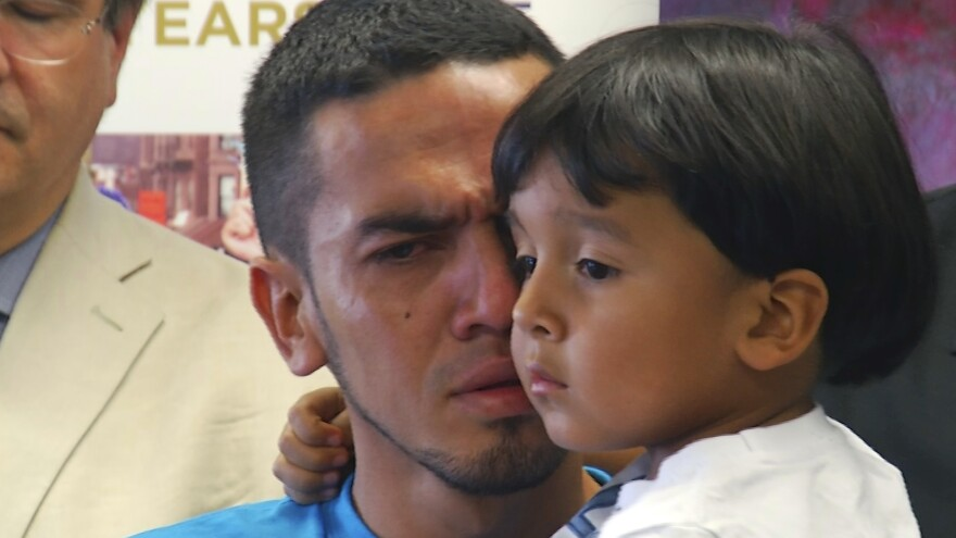 Javier Garrido Martinez holds his 4-year-old son after they were reunited on July 11, 2018, in New York.