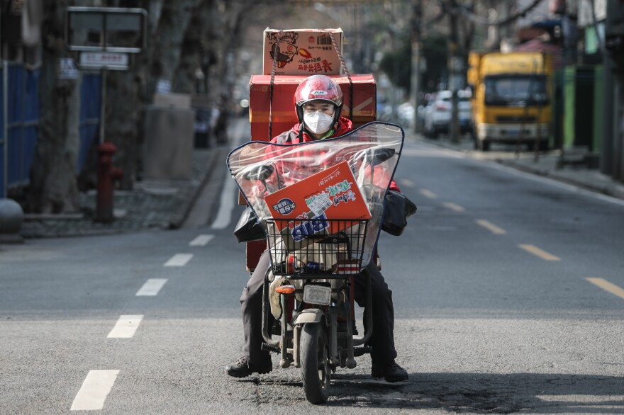 A courier with a scooter full of packages.