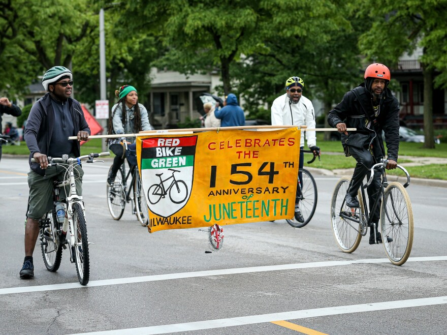Members of a parade perform during the Juneteenth Day Festival on June 19, 2019, in Milwaukee. In the wake of protests following the killing of George Floyd, there has been a push to make Juneteenth a federal holiday.