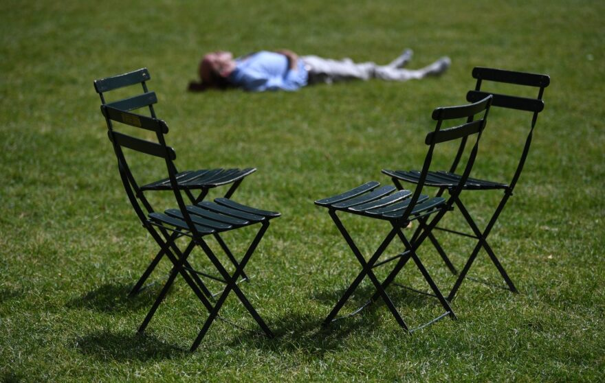 A man takes a nap on the Bryant Park Lawn in midtown New York City.