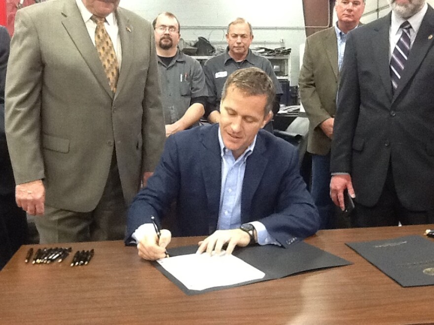 Gov. Eric Greitens signs into law a bill requiring stricter standards for expert witnesses in Missouri on March 28, 2017.