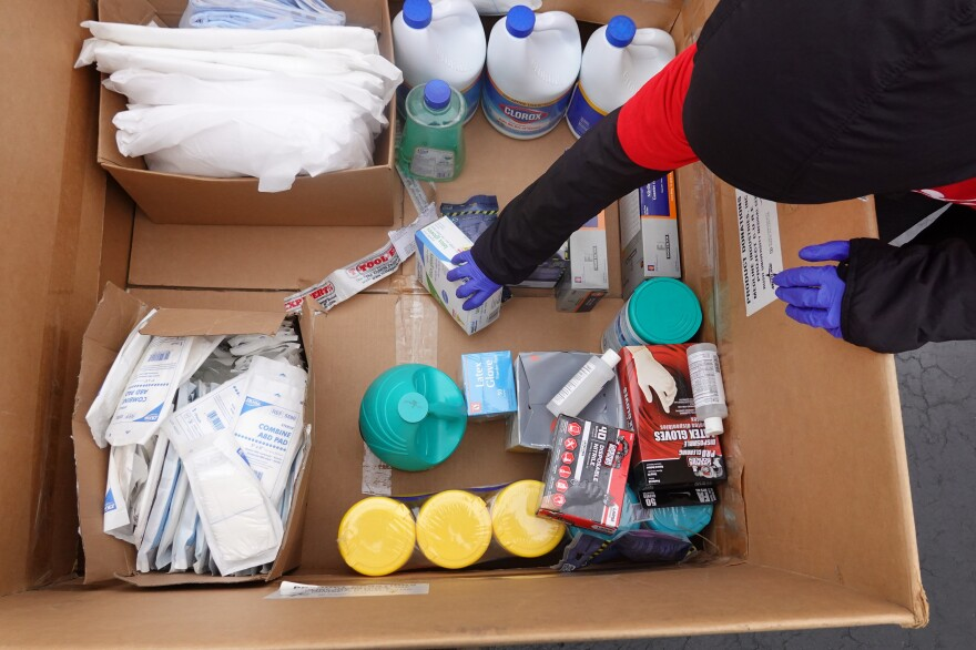 Staff and volunteers with Project CURE held a drive outside the United Center in Chicago to collect donations of PPE from the community which were then used to supply hospitals and clinics experiencing shortages on March 29, 2020.