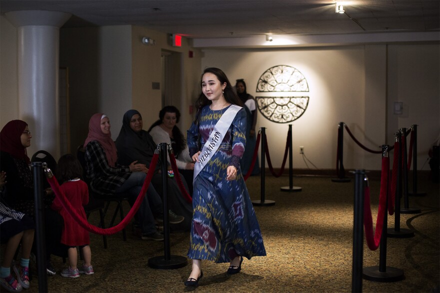The fashion show, which was part of the Council on American-Islam Relations in Missouri's third annual art exhibition, featured modest outfits from more than a half dozen countries, including Uzbekistan.