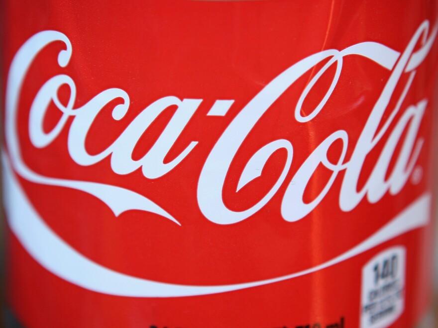 The Coca-Cola logo on a 24-ounce bottle.