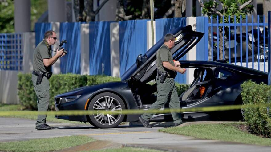 A BMW sits idle after reports of a shooting in Deerfield Beach involving Miami rapper XXXTentacion on Monday, June 18, 2018.