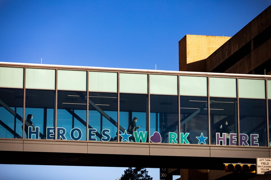 "A ""Heroes work here"" sign on the skybridge at Dell Seton Medical Center in Austin."