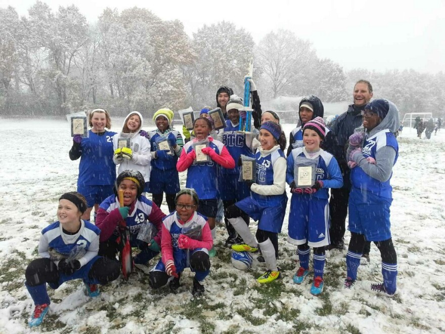 BreaDora Moore celebrates with her soccer team from the Blessed Teresa of Calcutta School.