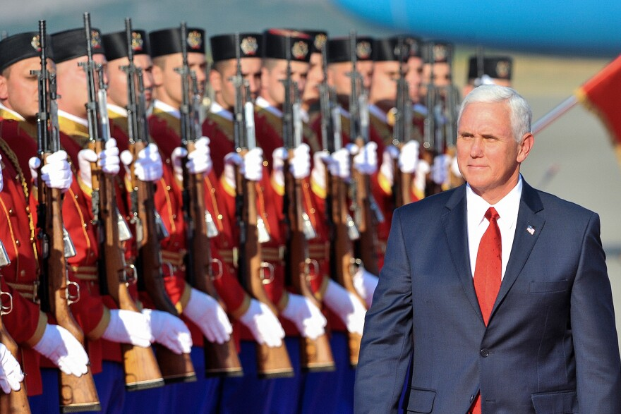 Pence reviews Montenegrin honor guards during a welcoming ceremony Monday. Montenegro is the newest member of the NATO alliance.