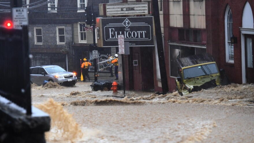 Ellicott City, Md.'s Main Street was turned into a raging river on Sunday, in a catastrophe that followed another flash flood in 2016. The water wrecked storefronts and left cars strewn amid debris on Monday.