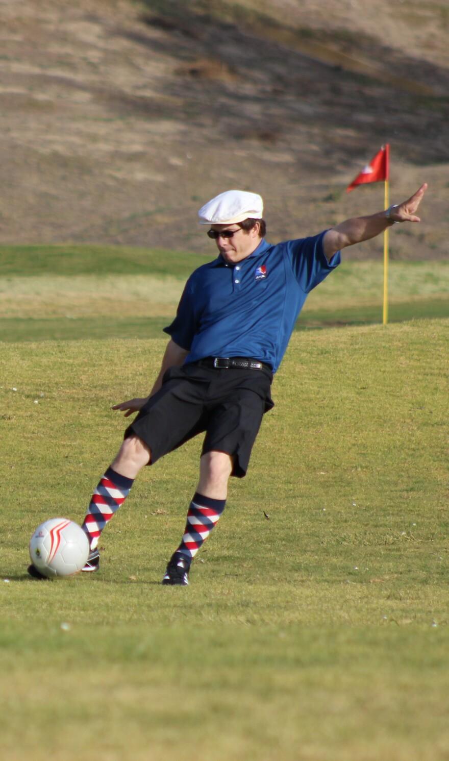 A FootGolfer, in argyle socks.
