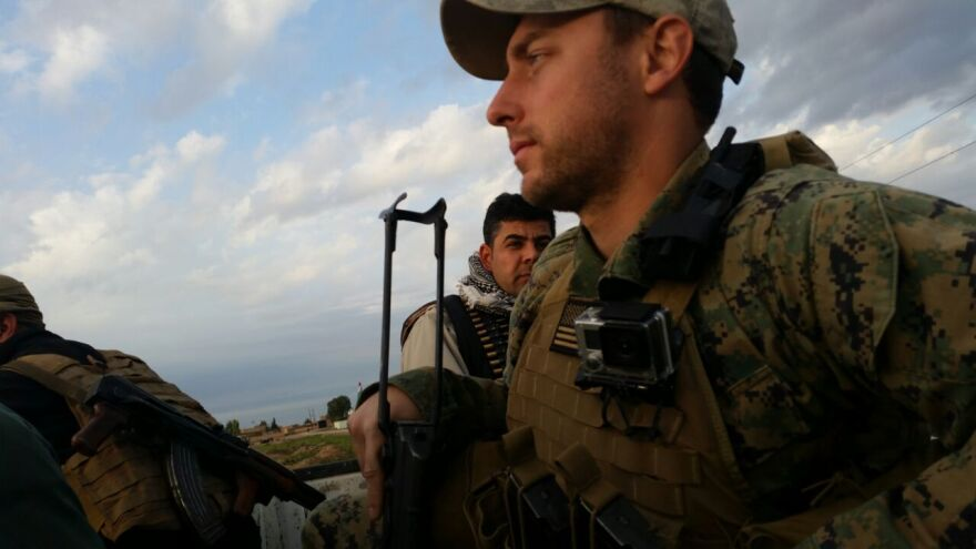 Texan Patrick Maxwell on patrol with Kurdish security forces in 2014.