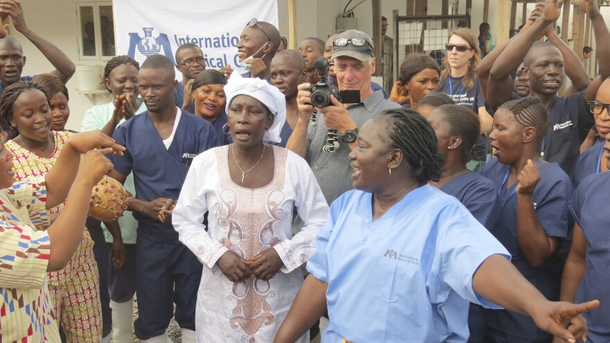 The WHO says transmission of Ebola has stopped in Sierra Leone. In August, Adama Sankoh, center, who contracted the virus after her son died from the disease, was cheered after being discharged from a treatment center near Freetown.
