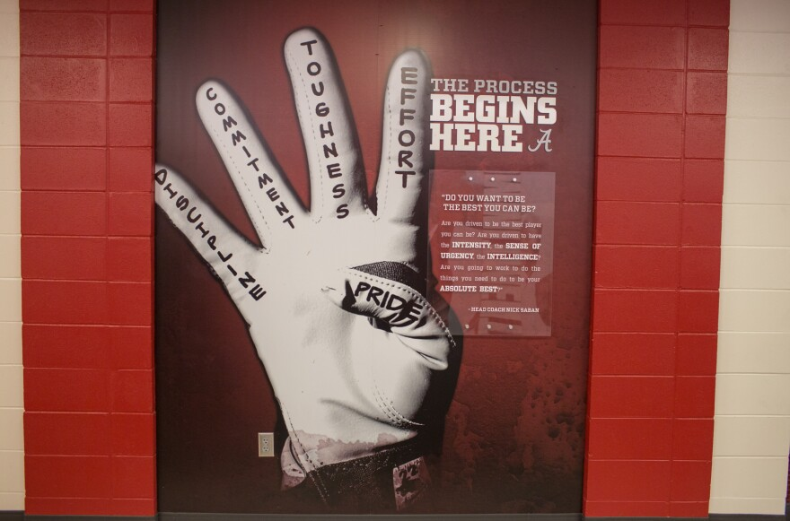 """Alabama Coach Nick Saban preaches """"the process"""" to his players. This sign near the team's practice facility gives reminders about what it takes to win."""