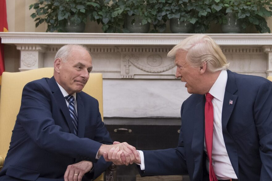 President Trump (right) shakes hands with newly sworn-in White House Chief of Staff John Kelly at the White House in Washington on July 31, 2017. (Jim Watson/AFP/Getty Images)