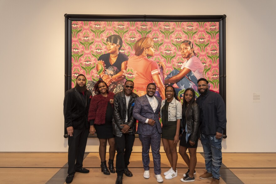 (L-R) Thomas Bradley, Adasia Carter, Brincel Kape'li Wiggins Jr., Kehinde Wiley, Ashley Cooper, Shontay Haynes and Arnold Tutson. Wiley found his portrait subjects at various places around St. Louis and Ferguson, including barbershops and a pizza place.