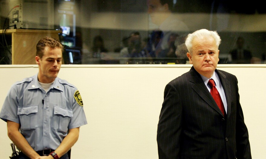 Former Yugoslav President Slobodan Milosevic enters the courtroom at the U.N. war crimes tribunal in the Hague, the Netherlands, in 2004. Despite strong political support from Russia, Milosevic was ousted and put on trial for genocide. He died in 2006 in his prison cell while the trial was ongoing.