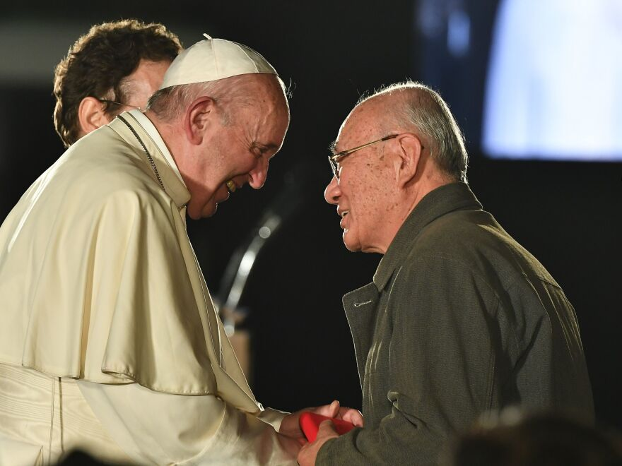 Pope Francis meets with a survivor of the 1945 atomic bombing of Hiroshima on Sunday.