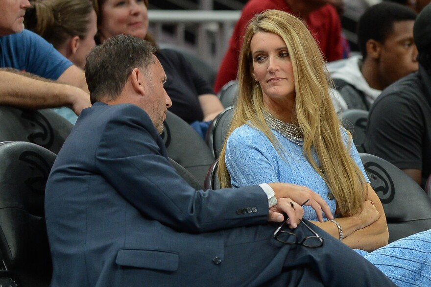 Georgia Gov. Brian Kemp plans to announce that he is naming Kelly Loeffler (right) as the state's next U.S. senator, replacing Johnny Isakson, who is stepping down for health reasons. Loeffler is an owner of the Atlanta Dream WNBA team and is shown here during a September game.