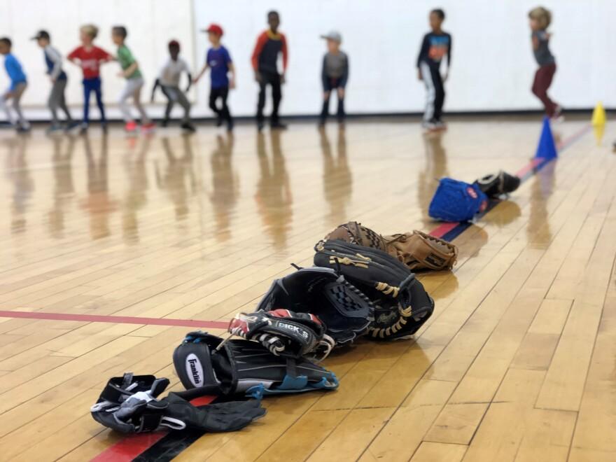 Kids do calisthenics before starting a baseball clinic in Washington, D.C.