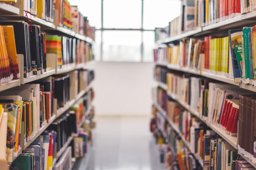 a shelf of brightly colored books.