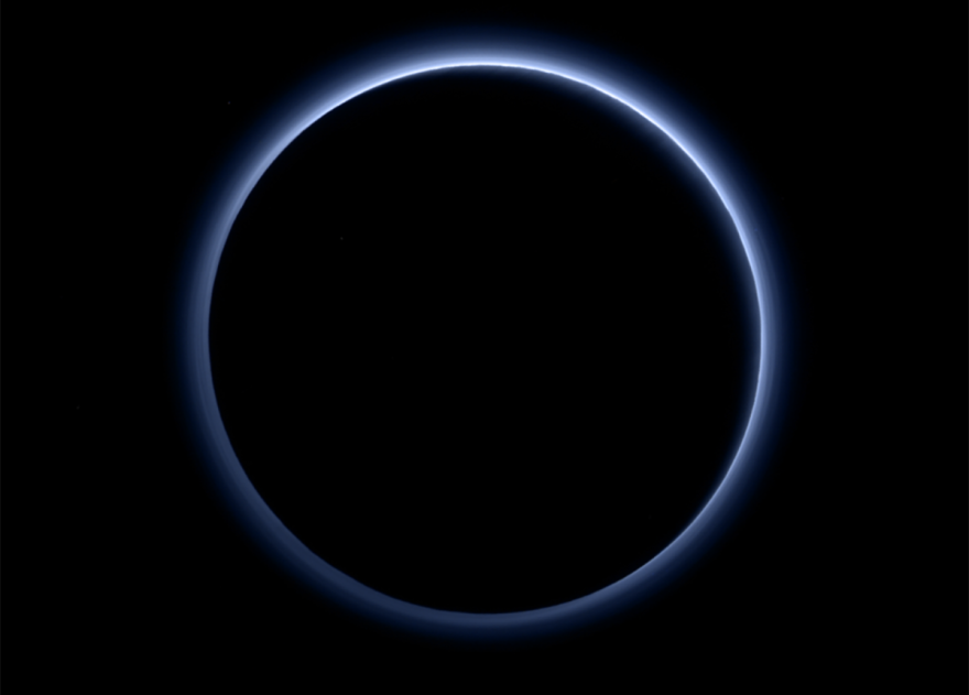 Pluto's atmosphere has a haze of blue, in this color picture taken by the New Horizons spacecraft that was released by NASA.