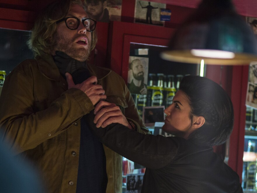 Weasel (Miller) gets roughed up by Angel Dust (Gina Carino), one of <em>Deadpool</em>'s bad guys.