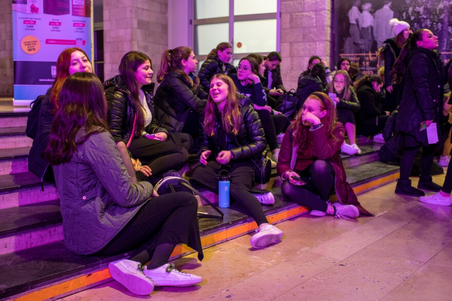 Women and girls flock to the women's <em>Siyum HaShas, </em>as the celebration for completing the Talmud is called.