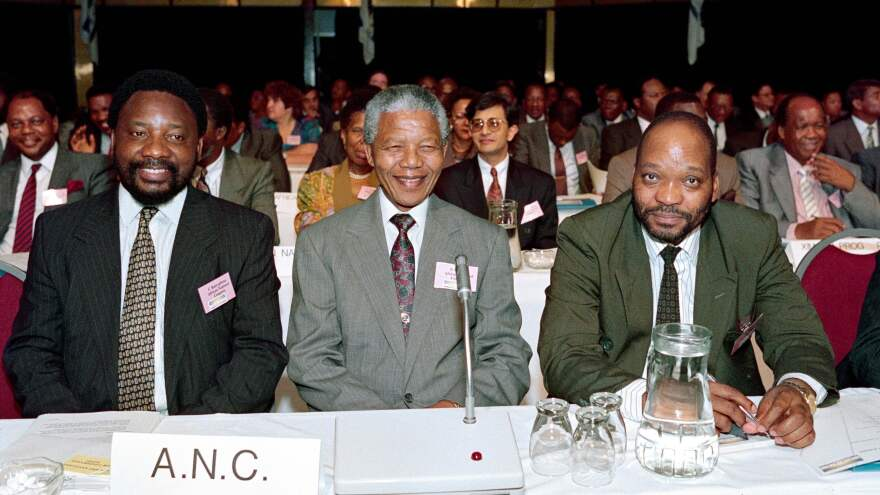 From left, Cyril Ramaphosa, Nelson Mandela and Jacob Zuma, representatives of the African National Congress party, attend the two-day Convention for a Democratic South Africa, in December 1991 in Johannesburg. The three represent half of the country's first six post-apartheid presidents.
