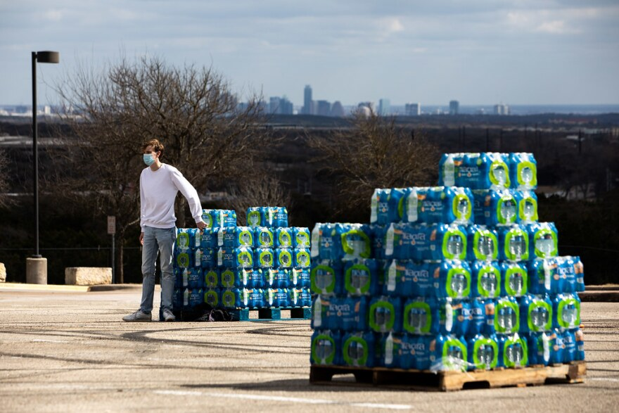 Volunteer Jake Nobles at a water distribution event held by the City of Austin and Travis County at the ACC Pinnacle campus in Southwest Austin on Sunday.